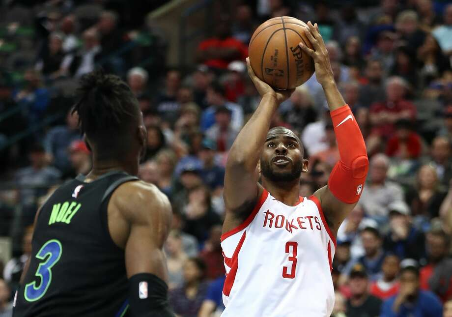 DALLAS, TX - MARCH 11:  Chris Paul #3 of the Houston Rockets takes a shot against Nerlens Noel #3 of the Dallas Mavericks at American Airlines Center on March 11, 2018 in Dallas, Texas.  NOTE TO USER: User expressly acknowledges and agrees that, by downloading and or using this photograph, User is consenting to the terms and conditions of the Getty Images License Agreement.  (Photo by Ronald Martinez/Getty Images) Photo: Ronald Martinez/Getty Images