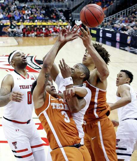 Texas' Jacob Young (3) and Jericho Sims didn't win against Texas Tech, but they made the NCAAs. Photo: Jamie Squire / Getty Images / 2018 Getty Images