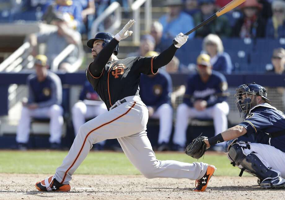 San Francisco Giants' Mac Williamson follows through on his three-run home run during the fifth inning of a spring training baseball game against the Milwaukee Brewers, Wednesday, Feb. 28, 2018, in Maryvale, Ariz. (AP Photo/Carlos Osorio) Photo: Carlos Osorio, Associated Press