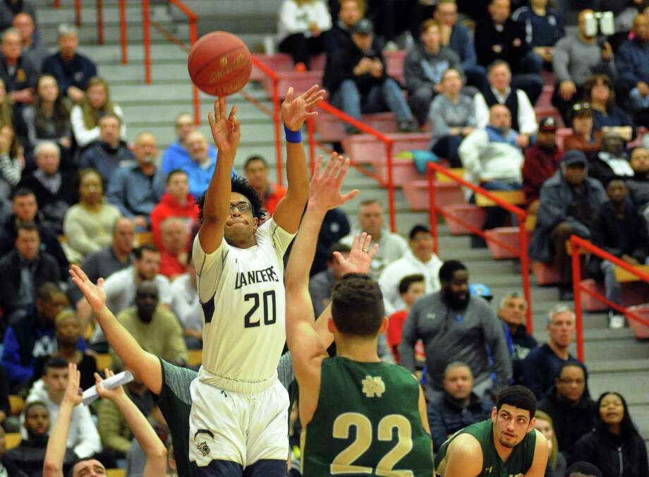 Noreaga Davis and his Notre Dame-Fairfield teammates play Danbury in a CIAC Division 1 game on Monday night in Trumbull. The winner advances to the semifinals on Thursday night. Photo: Christian Abraham / Hearst Connecticut Media