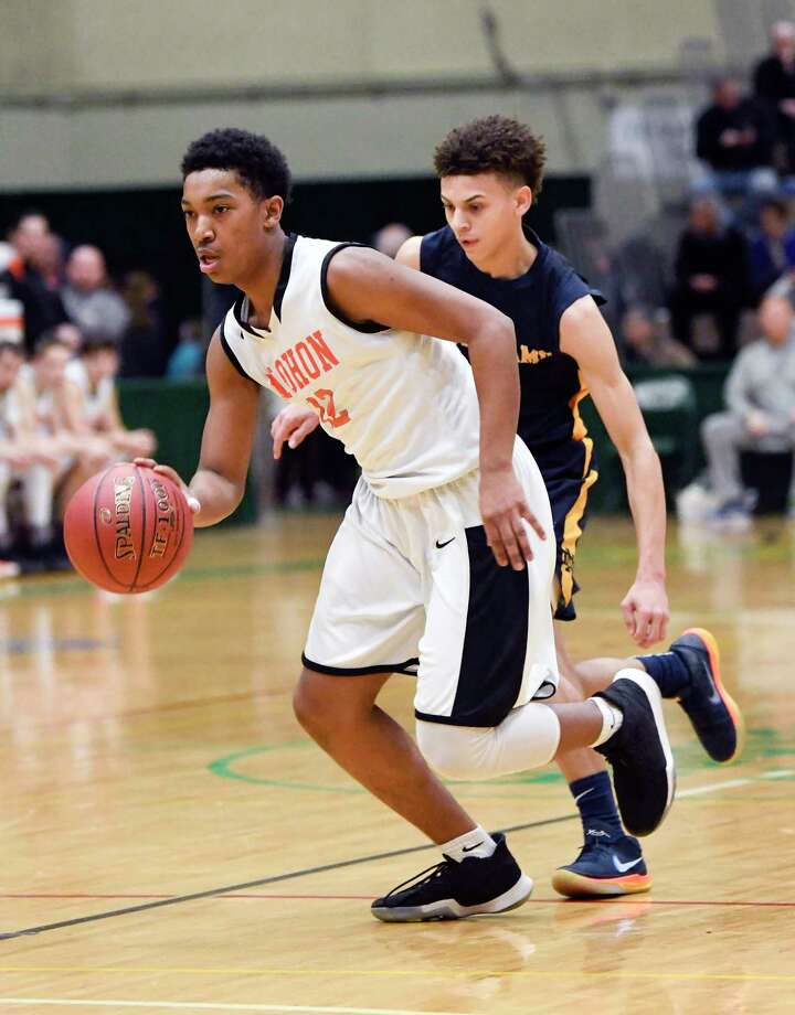 Mohonasen's Jalani Abdul-aziz (12) moves the ball against Utica Notre Dame during a Class A boys' high school basketball state quarterfinal game Saturday, March 10, 2018, in Troy, N.Y. (Hans Pennink / Special to the Times Union) Photo: Hans Pennink / Hans Pennink