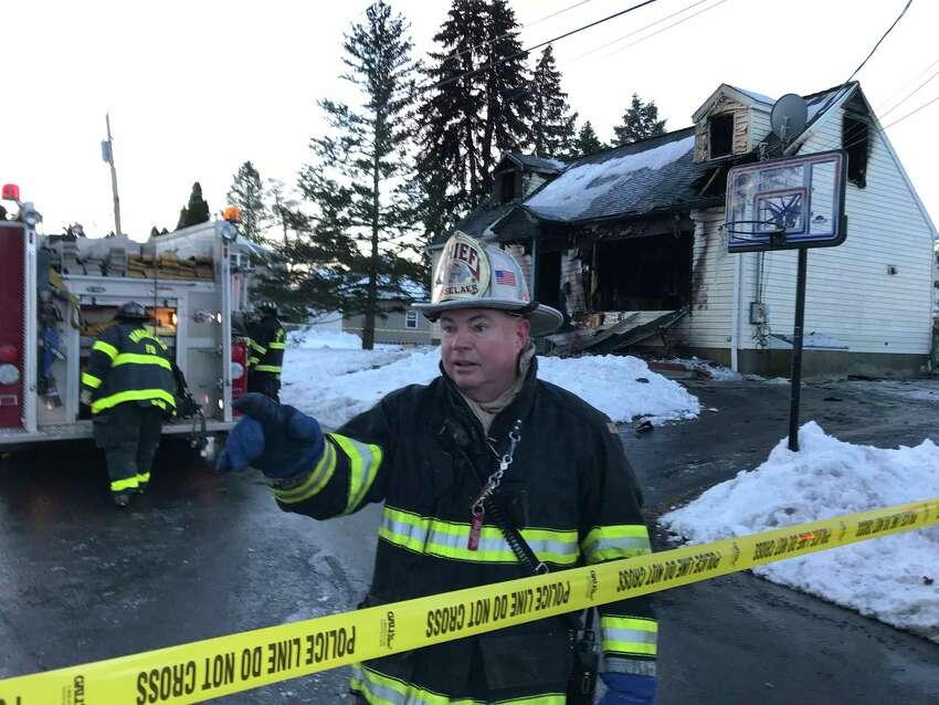 Rensselaer Fire Chief Bill Hummel outside the fire scene at 900 Mann St., Rensselaer, where three died last March.