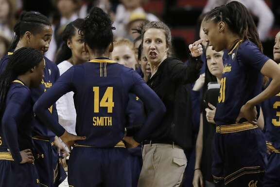 California coach Lindsay Gottlieb, second from right, talks to her team during a timeout in the second half of an NCAA college basketball game against UCLA in the quarterfinals of the Pac-12 women's tournament Friday, March 2, 2018, in Seattle. UCLA won 77-74. (AP Photo/Ted S. Warren)