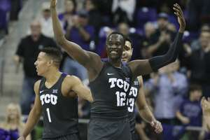 TCU forward Kouat Noi (12) celebrates near the end of their game with Baylor during an NCAA college basketball game, Saturday, Feb. 24, 2018, in Fort Worth, Texas. (Rod Aydelotte/Waco Tribune Herald, via AP)