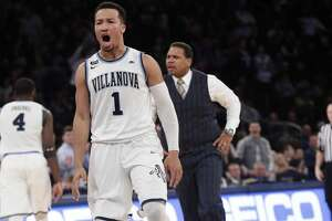 Providence head coach Ed Cooley, right, and Villanova's Jalen Brunson (1) react after Brunson made a three point basket during the second half of an NCAA college basketball game in the Big East men's tournament finals Saturday, March 10, 2018, in New York. (AP Photo/Frank Franklin II)