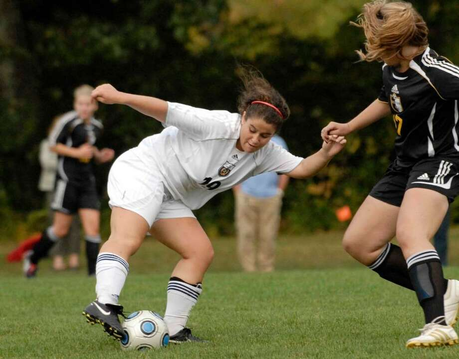 Averill Park's Melissa Gentile, left, trys to bring the ball around a Ballston Spa defender. (Michael P. Farrell / Times Union ) Photo: MICHAEL P. FARRELL / 00005597A