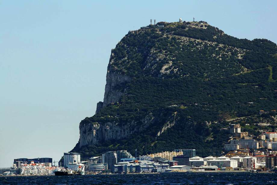 Commercial and residential buildings stand along the waterline at the base of the rock of Gibraltar on March 6, 2016. Gibraltar is a 300-year-old British territory on the southern tip of Spain. Photo: Bloomberg Photo By Luke MacGregor. / © 2016 Bloomberg Finance LP