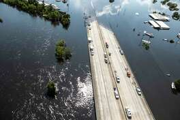 Interstate 10 is submerged by floodwaters of Tropical Storm Harvey on Friday, Sept. 1, 2017, Vidor, Texas. ( Brett Coomer / Houston Chronicle )