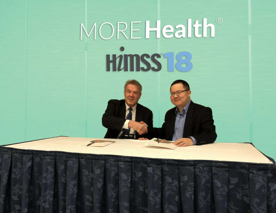 Ted Bukowski, SVP of Provider Partnerships at MORE Health, and Dr. Hua Xu, CEO of Melax Technologies signing the agreement for a joint research project. Courtesy of  MORE Health Inc. / This image must be used within the context of the news release it accompanied. Request permission from issuer for other uses.