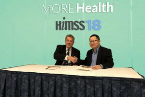 Ted Bukowski, SVP of Provider Partnerships at MORE Health, and Dr. Hua Xu, CEO of Melax Technologies signing the agreement for a joint research project. Courtesy of  MORE Health Inc.