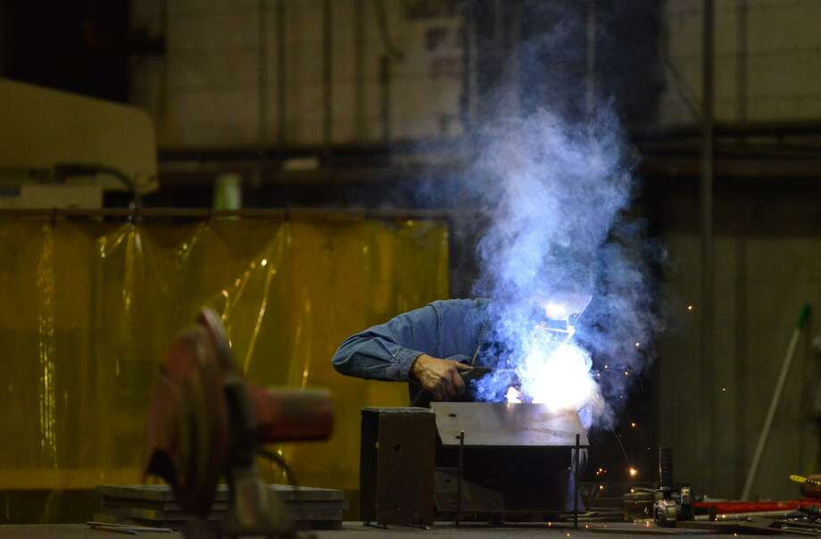 Maurice Flores welds at Alamo Iron Works. President Donald Trump has imposed tariffs on imported steel and aluminum, excluding Mexico and Canada. Photo: Robin Jerstad /San Antonio Express News