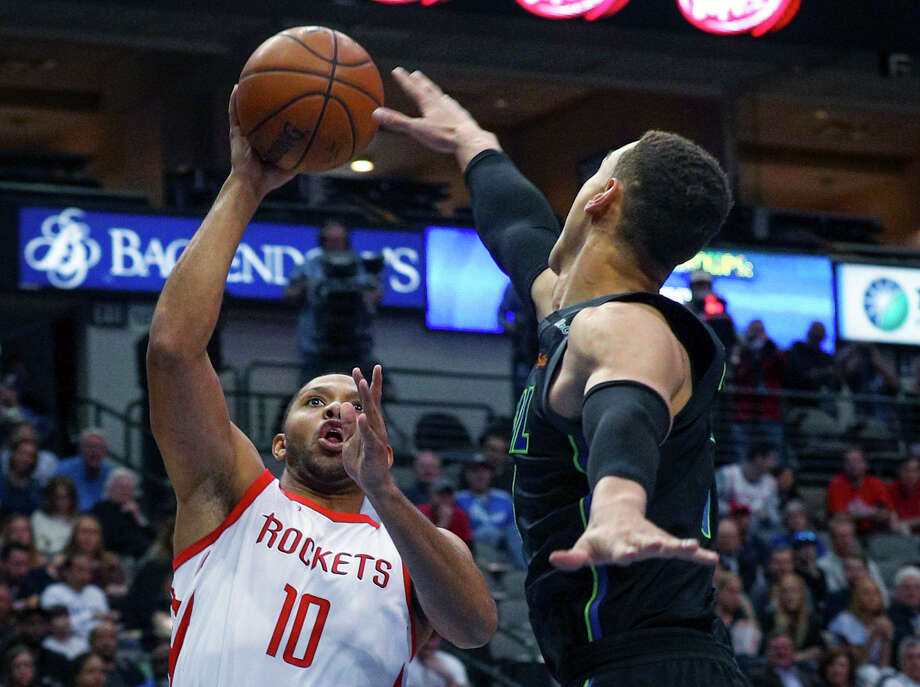 Houston Rockets guard Eric Gordon (10) puts up a shot against Dallas Mavericks center Dwight Powell (7) in the first half of an NBA basketball game Sunday, March 11, 2018 in Dallas. (AP Photo/ Richard W. Rodriguez) Photo: Richard W. Rodriguez, Associated Press / FR170526 AP