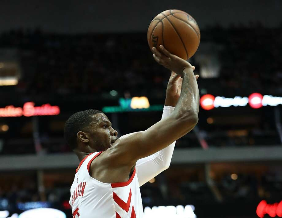 DALLAS, TX - MARCH 11:  Joe Johnson #7 of the Houston Rockets takes a shot against the Dallas Mavericks at American Airlines Center on March 11, 2018 in Dallas, Texas.  NOTE TO USER: User expressly acknowledges and agrees that, by downloading and or using this photograph, User is consenting to the terms and conditions of the Getty Images License Agreement.  (Photo by Ronald Martinez/Getty Images) Photo: Ronald Martinez/Getty Images