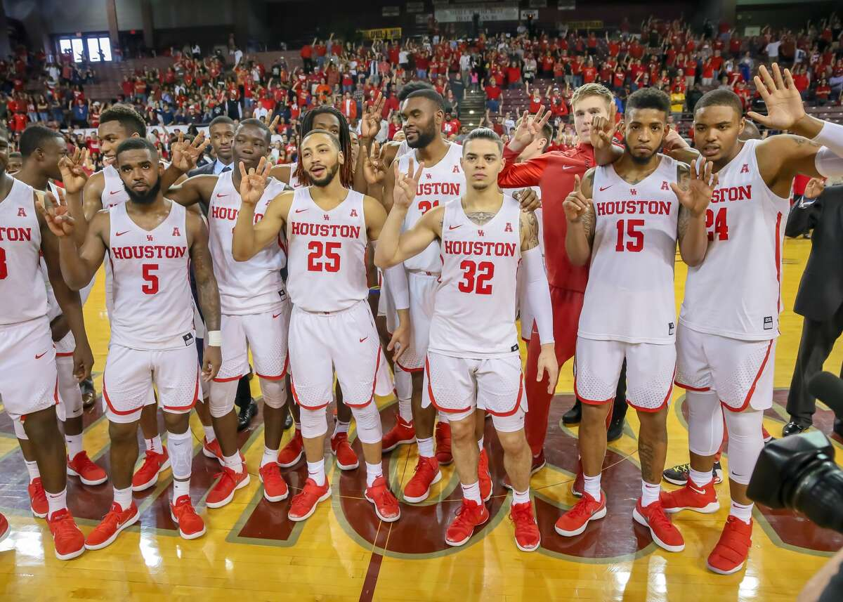 HOUSTON, TX - MARCH 04: Houston Cougars players celebrate after ending the regular season undefeated at home during the men's basketball game between the UConn Huskies and Houston Cougars on March 4, 2018 at H&PE Arena in Houston, Texas. (Photo by Leslie Plaza Johnson/Icon Sportswire via Getty Images)