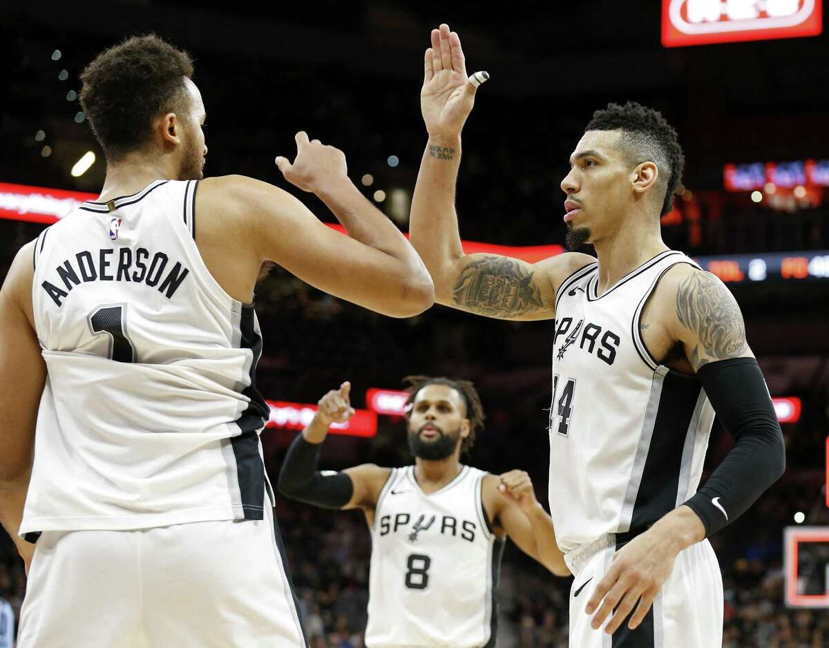 San Antonio Spurs forward Kyle Anderson (1) Patty Mills (8), and Danny Green (14) celebrate after the game against the Memphis Grizzlies Monday March 5, 2018 at the AT&T Center.
