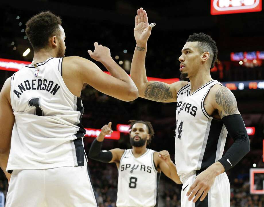 San Antonio Spurs forward Kyle Anderson (1) Patty Mills (8), and Danny Green (14) celebrate after the game against the Memphis Grizzlies Monday March 5, 2018 at the AT&T Center. Photo: Edward A. Ornelas, Staff / San Antonio Express-News / © 2018 San Antonio Express-News