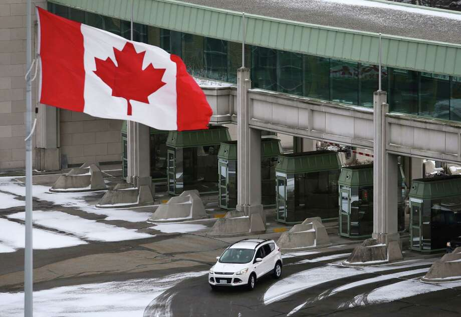 A vehicle makes its way through the Canadian border crossing in Niagara Falls, Ontario, Canada, on Jan. 23, 2016. Thanks to Donald Trump's restrictive policies, skilled immigrants are turning to Canada instead -- a big problem for the U.S. economy. Photo: Cole Burston/Bloomberg / Bloomberg