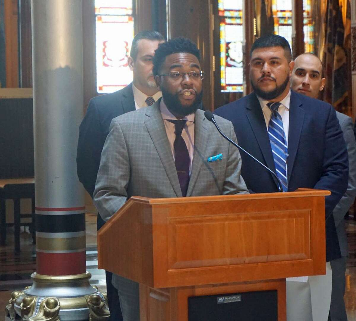 State Rep. Brandon McGee, D-Hartford, vice chair of the Black and Puerto Rican Caucus, outlined the caucus's legislative priorities with (right) chair of the caucus Rep. Christopher Rosario, D-Bridgeport, at the Capitol in Hartford, Conn. on Monday, March 12, 2018.
