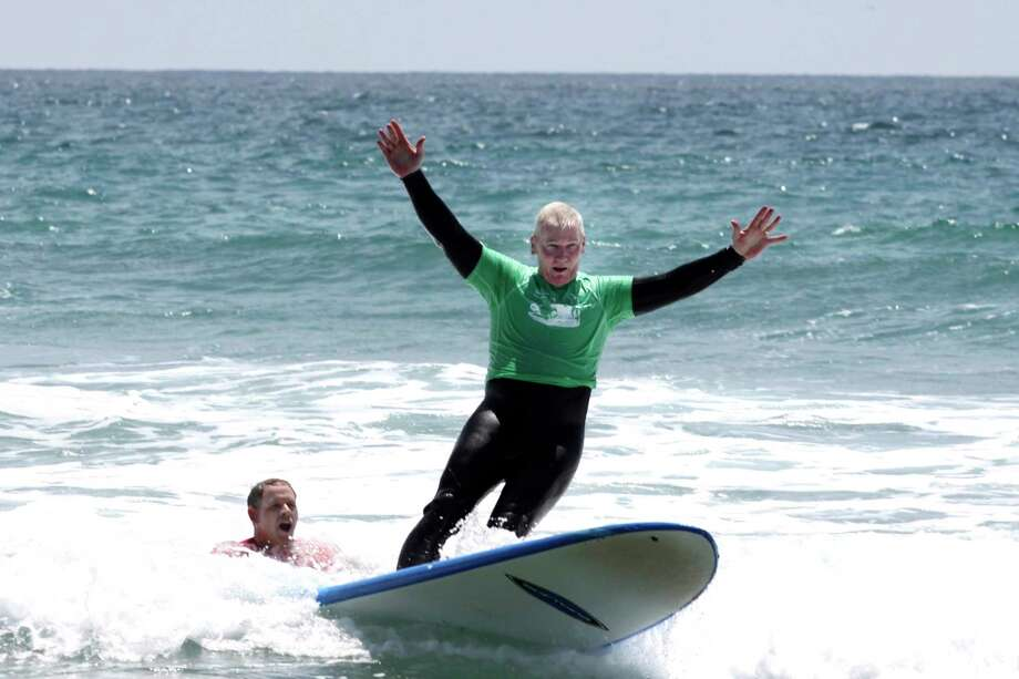 Marine Lt. Gen. John Toolan surfs at Marine Corps Base Camp Pendleton with the Jimmy Miller Foundation in 2014. Photo: Courtesy Of The Jimmy Miller Foundation. / Handout
