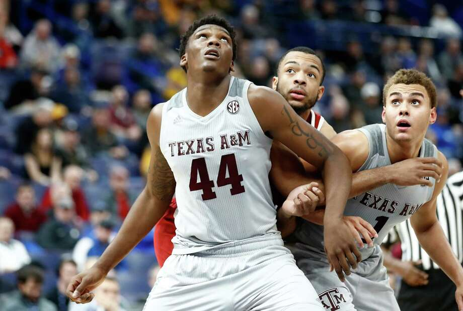 ST LOUIS, MO - MARCH 08:  Robert Williams #44 of the Texas A&M Aggies boxes out for a rebound against the Alabama Crimson Tide during the second round of the 2018 SEC Basketball Tournament at Scottrade Center on March 8, 2018 in St Louis, Missouri. Photo: Andy Lyons, Getty Images / 2018 Getty Images