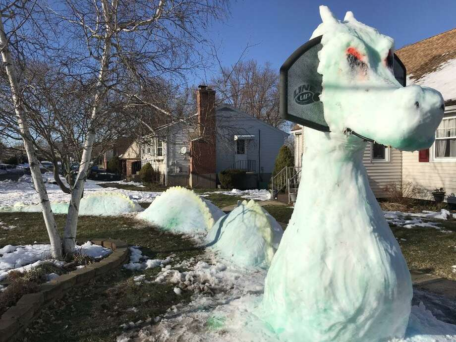 Meet Zadora, the sea protector, created by Karen Terrio-Malave and her son Will Malave with help from Kathryn Post and Bryan Kotlarz. Middletown residents look forward every year to the unveiling of the family's snow sculpture on Fowler Avenue. Terrio-Malave began forming the basic shape of her creature Wednesday night during the snowstorm and continued to fine tune it the rest of the week. Sunday, after four more hours of work, the family's first female sculpture was born. It was Will Malave's idea to incorporate the basketball hoop, his mother said. In past years, the home has featured several characters, including Gator the alligator, Texx, Will's pitbull; Drake the dragon and Ivan the gargoyle. Photo: Contributed Photo