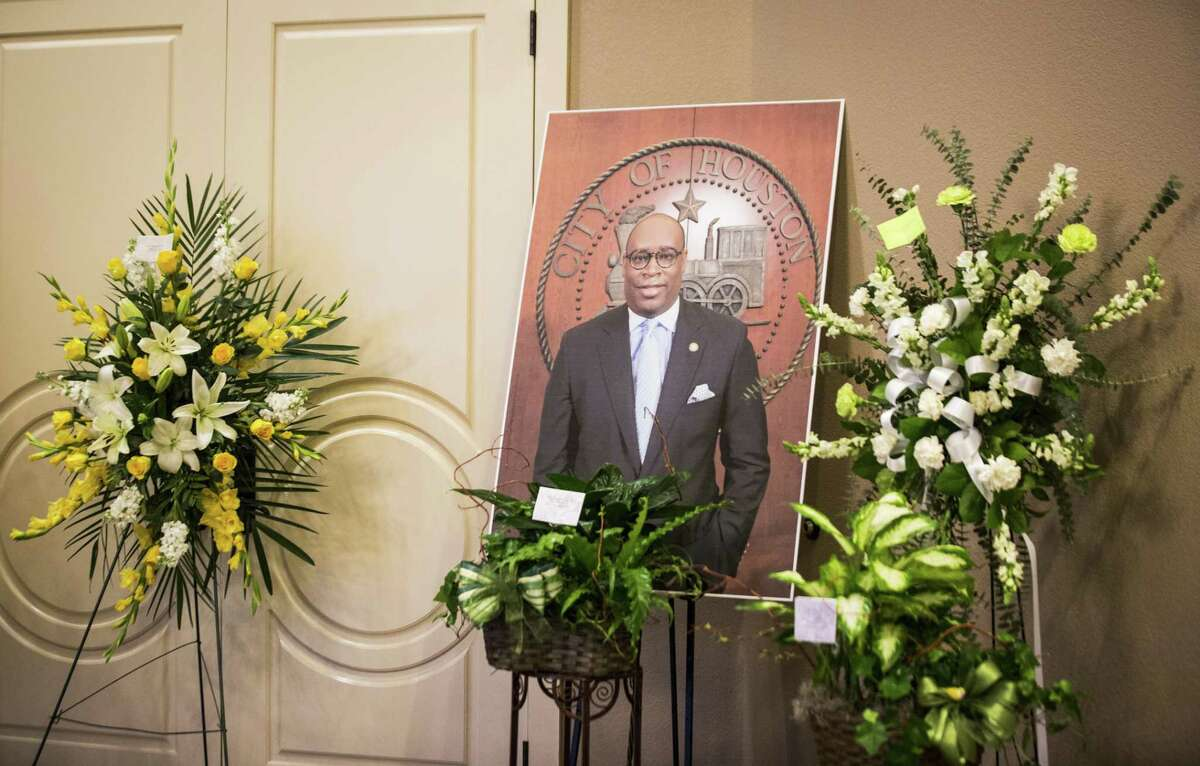 A photograph of Houston City Councilman Larry Green is placed surrounded by flower arrangement gifts at Sugar Land Mortuary, Sunday, March 11, 2018, in Sugar Land. ( Marie D. De Jesus / Houston Chronicle )