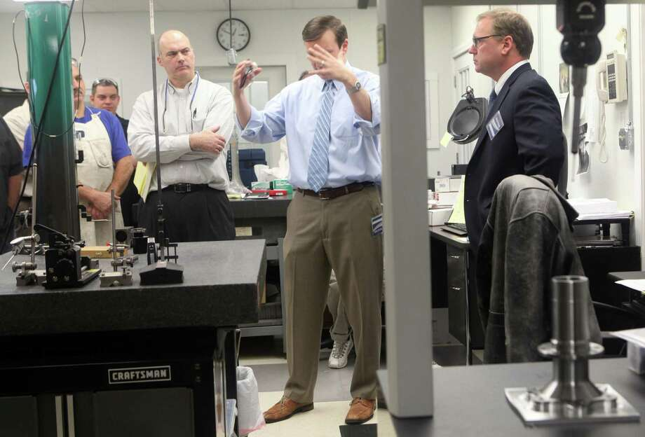 Straton Industries, a machining contractor in Stratford, is among the manufacturers that expanded in 2017. In this 2013 picture, U.S. Sen. Chris Murphy, center, and then-Stratford Mayor John Harkins, right, visited Straton. David Cremin, the Straton president, is at left. Photo: BK Angeletti / B.K. Angeletti / Connecticut Post freelance B.K. Angeletti