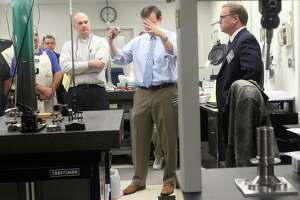 Straton Industries, a machining contractor in Stratford, is among the manufacturers that expanded in 2017. In this 2013 picture, U.S. Sen. Chris Murphy, center, and then-Stratford Mayor John Harkins, right, visited Straton. David Cremin, the Straton president, is at left.