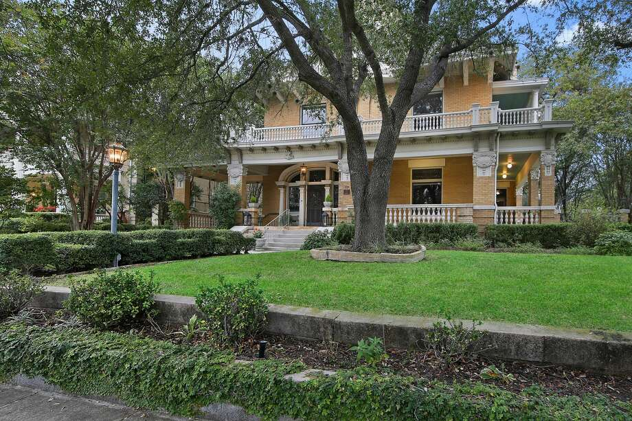 The historic home at 501 W. French Place in San Antonio is on the market for $1,199,000. The 115-year-old house is 6,098 sq. ft. and has 3 bedrooms and 2.5 bathrooms, as well as a 2-bedroom, 1-bathroom carriage house. Photo: Courtesy, Jason Glast Luxury Real Estate