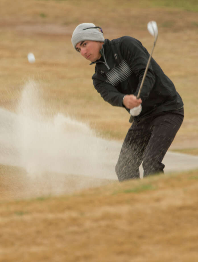Midland College's Michael Salazar hits out of a bunker 03/12/18 during the Omega Treating Chemical Green Tree Country Club Invitational at Green Tree Country Club. Tim Fischer/Reporter-Telegram Photo: Tim Fischer/Midland Reporter-Telegram