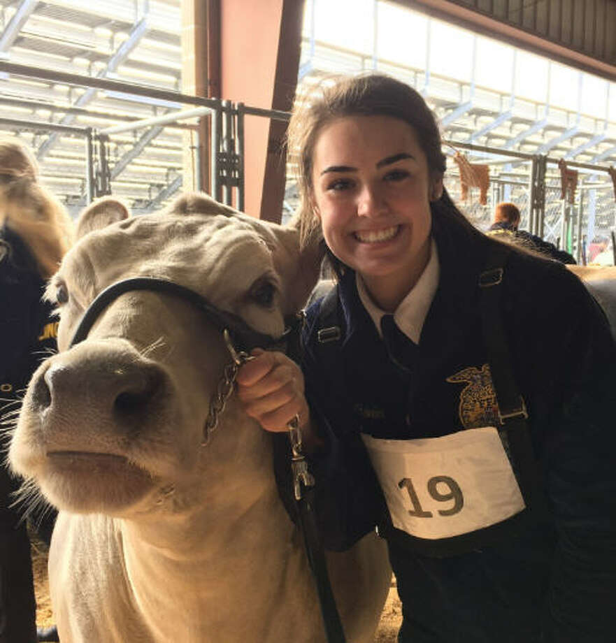 Cinco Ranch High School junior Rachel Wheeler raised the grand champion steer for the 2017 Katy Independent School District FFA Livestock Show & Auction. Jax sold for $20,000. The grand champion steer last year sold at auction for $13,500. Photo: Karen Zurawski