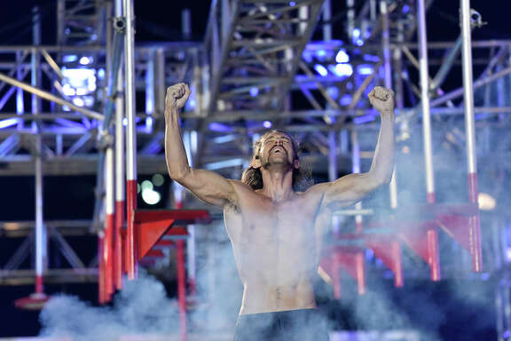 "Isaac Caldiero celebrates after his stage 3 victory in NBC's ""American Ninja Warrior."""