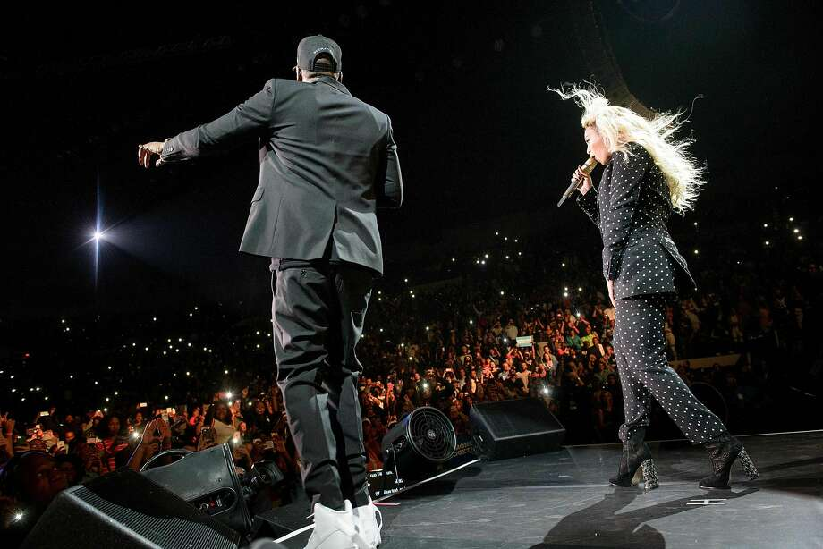 (FILES) In this file photo taken on November 4, 2016 Beyonce (L) and Jay Z perform during a Get Out the Vote (GOTV) performance in support of Democratic presidential nominee Hillary Clinton at the Wolstein Center in Cleveland, Ohio. Music's first couple Beyonce and Jay-Z on March 12, 2018 announced a new joint tour in what will likely mark some of the year's most lucrative concerts.The rapper and diva, who in June gave birth to twins, will open the stadium tour on June 6 in the Welsh city of Cardiff.The 36-date show will travel across Europe, including a Bastille Day show at the Stade de France in Paris, before a North American leg that closes on October 2 in Vancouver.  / AFP PHOTO / Brendan SmialowskiBRENDAN SMIALOWSKI/AFP/Getty Images Photo: BRENDAN SMIALOWSKI, AFP/Getty Images