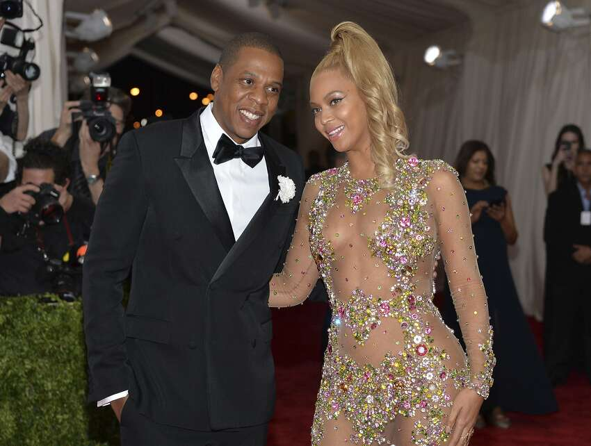 FILE - In this May 4, 2015, file photo, Jay Z, left, and Beyonce arrive at The Metropolitan Museum of Art's Costume Institute benefit gala celebrating