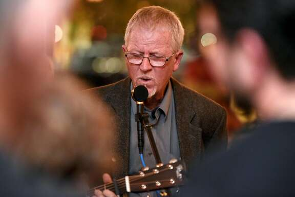 """Winemaker and musician Steve Edmunds performs during a release party for his new album, """"Singing to the Ghosts"""", at Pompette Cafe in Berkeley, CA, on Monday February 19, 2018."""