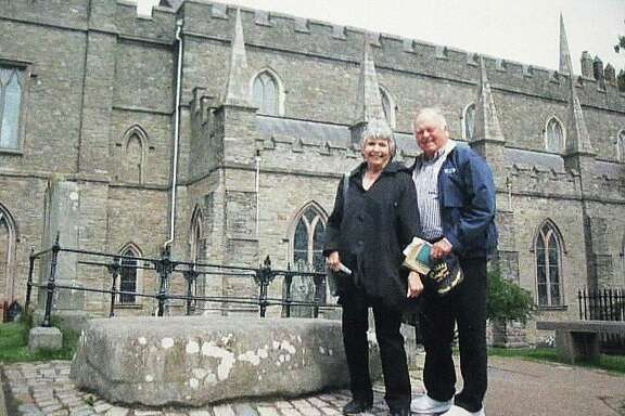 Sandra and Jim Sterling stand next to the tomb of St. Patrick in Downpatrick, Ireland on one of their many trips to the Emerald Isle.