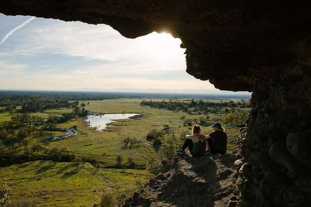 Sophie Podeswik and Jessica Godbout enjoy the view at Monkey Face at the Upper Bidwell Park in Chico, Calif., Saturday, March 3, 2018.
