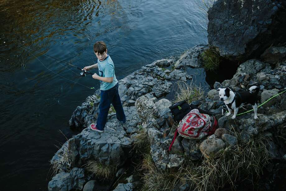 Liam Rielly, 13, fishes with his dog, Rogue Oregon, on the Big Chico Creek in Upper Bidwell Park in Chico, a city park that is three times the size of Golden Gate Park. Photo: Mason Trinca, Special To The Chronicle