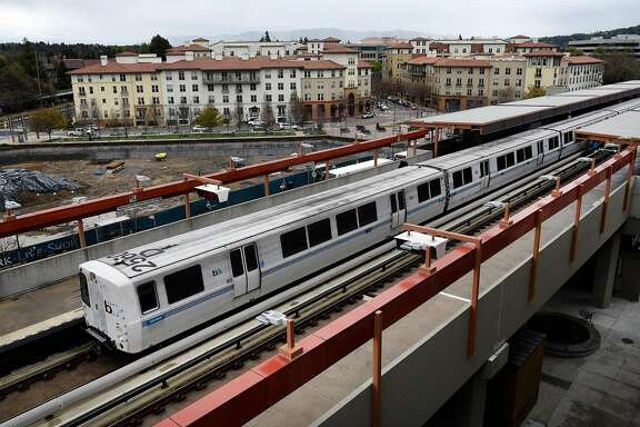 A train leaves the platform at the Pleasant Hill BART Station as the Avalon Walnut Creek Apartments, part of the   Contra Costa Centre, are seen in the background, in Walnut Creek, CA, on Friday March 2, 2018.