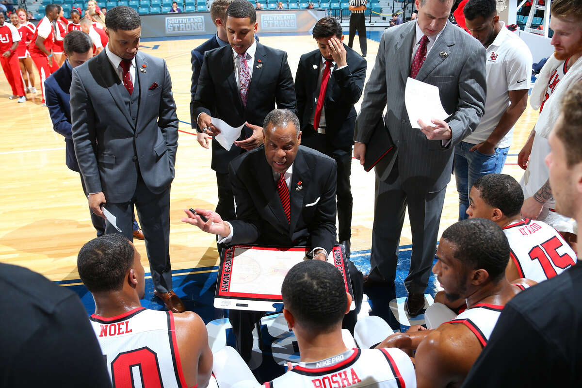 Lamar men's basketball coach Tic Price instructs his team during a timeout in the Cardinals first-round loss to Central Arkansas at the Southland Conference tournament on Wednesday, March 14, 2018 (Photo provided by Southland Sports)