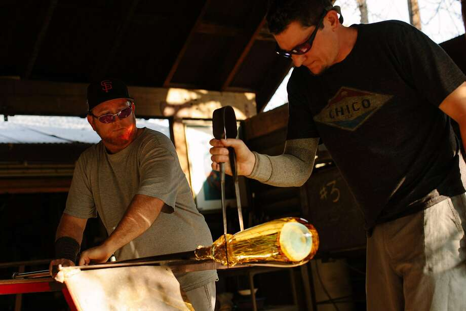 Wyatt Campbell and Mark Del Fava shape the glass at the Satava Art Glass Studio in Chico. Photo: Mason Trinca, Special To The Chronicle