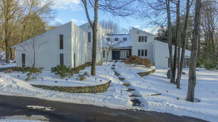 The contemporary house at 1 Winslow Road in Weston is like a spa/resort with an indoor swimming pool, sauna, exercise room, aerated pond, and immediate access to managed hiking trails and protected open space. Photo: Contributed Photos