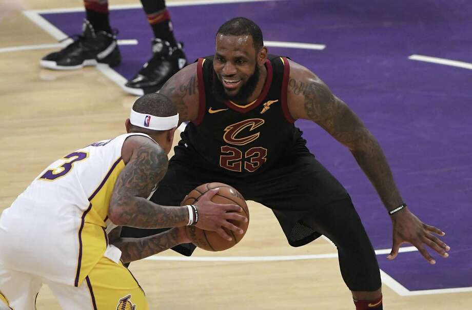 Cleveland Cavaliers forward LeBron James, right, laughs as he defends against Los Angeles Lakers guard Isaiah Thomas during the second half of an NBA basketball game, Sunday, March 11, 2018, in Los Angeles. The Lakers won 127-113. (AP Photo/Mark J. Terrill) Photo: Mark J. Terrill, STF / Associated Press / Copyright 2018 The Associated Press. All rights reserved.