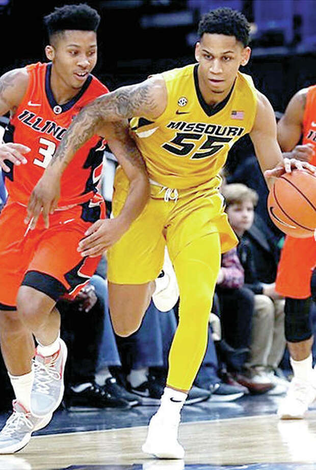 Missouri's Blake Harris (55) controls the ball against Te'Jon Lucas of Illinois in the Tigers' Braggin' Rights Game loss to Illinois in December. Photo: Mizzou Athletics Photo