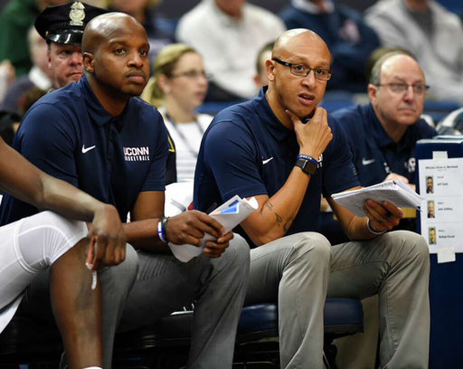 Associate Head Coach Raphael Chillious, middle, has been named interim head coach at UConn. Kevin Ollie was fired by the university on Saturday. / AP2017