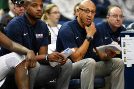 Associate Head Coach Raphael Chillious, far right, has been named interim head coach at UConn. Kevin Ollie was fired by the university on Saturday.
