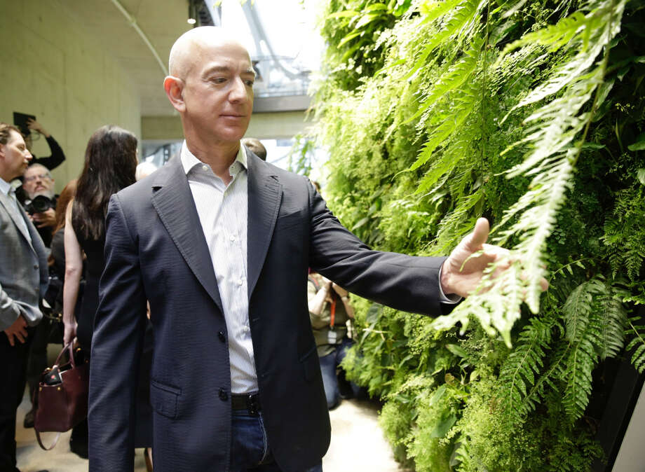 The city Jeff Bezos selects for the second Amazon headquarters can accelerate clean energy initiatives that extend well beyond the new campus's perimeter. Photo: Jason Redmond / AFP / Getty Images