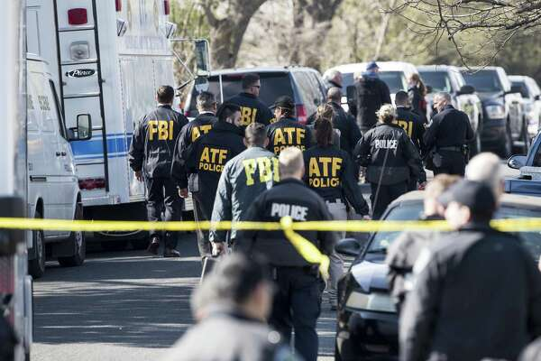 Authorities investigate the scene in East Austin after a teenager was killed and a woman was injured in the second Austin package explosion in the past two weeks on Monday, March 12, 2018. (Ricardo B. Brazziell/Austin American-Statesman/TNS)