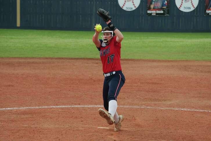 Dawson's Courtney Day (17) pitches against Tompkins Friday, Feb. 23 at Dawson High School.