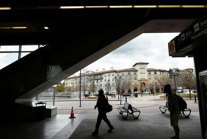 The Avalon Walnut Creek Apartments in the Contra Costa Centre are seen in the background as people walk through the Pleasant Hill BART Station in Walnut Creek, CA, on Friday March 2, 2018.